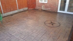 Printed Concrete Patio in Ashlar Slate with Compass Feature