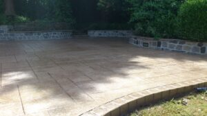 Printed Concrete Patio in Ashlar Slate with Raised Soldier Course