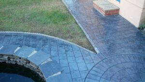 Printed Concrete Paths and Pond Surround in London Cobble