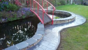 Printed Concrete Pond Surround in London Cobble