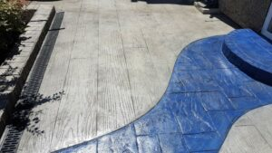 Printed Concrete Wood Effect Patio with Blue Slate Inset Path