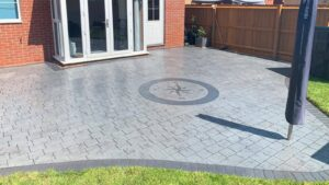 DCS Printed Concrete Patio in Platinum Grey London Cobble with a Compass Feature Circle